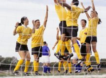 Soccer team cheering after