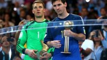Manuel Neuer of Germany obtains the Golden Glove trophy and Lionel Messi of Argentina receives the Golden Ball
