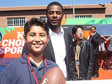 TFK Kid Reporter Lorenzo Blanco presents with New England Patriots soccer player Malcolm Butler.