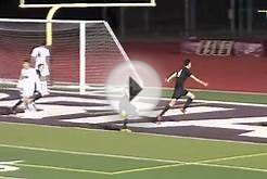 High School Soccer Player Scores Goal with Expert-Level